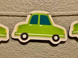 green car banner vehicle motorcar