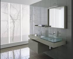 marvelous modern bathroom design featuring ceramic wall and floor tiles plus floating vanity with glass sink and wall mirror