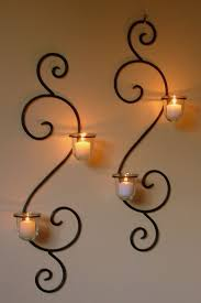 using wrought iron candle holders as