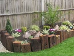 this next wood landscape edging idea comes to us from with no known source but we have some easy instructions for you for a similar project next