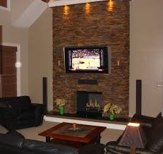 interior brown stone fireplace wall with lcd tv on over mantel added by black leather