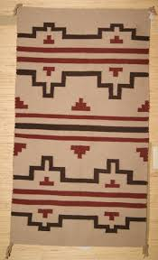 navajo rug with a stepped design for photo 1
