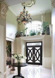above front door decor love the details ledge above this front door and the ceiling medallion