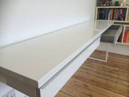assembly and review of the ikea besta burs high gloss desk