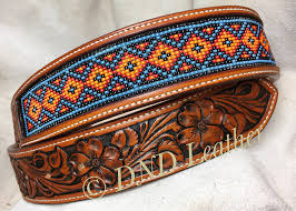 beaded leather belt with one of my ever changing dogwood tooling