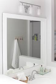 diy bathroom mirror frame. Since Our Bathroom Makeover Was Pretty Budget Friendly, We Decided To Frame The Vanity Mirrors. Diy Mirror L