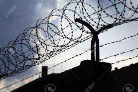 barbed wire fence prison. Dramatic Clouds Behind Barbed Wire Fence On A Prison Wall Stock Photo - 56370250 S