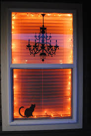 haunted house lighting ideas. i love this halloween window decor idea with orange lights and black silhouettes haunted house lighting ideas n