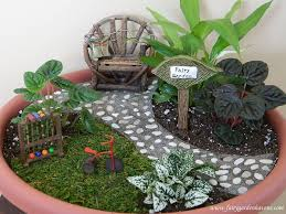 sweet and simple little fairy garden in a flower pot