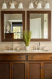 tropical bathroom lighting. Meritage Homes Charlotte Nc Tropical Bathroom Also Double Sink Vanity Framed Mirror Stainless Steel Faucet Triple Light Sconce Lighting Top