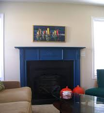 ornate blue painted fireplace mantel with artwork wall decors also charming sofa in modern living areas decors views