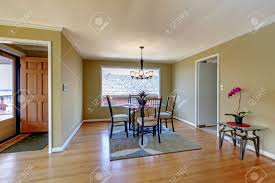 Kitchen And Dining Room Flooring Dining Room With Flont Door And Hardwood Floor And Round Glass