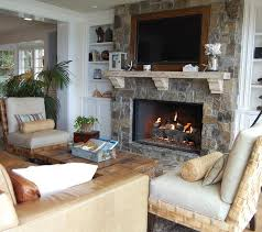 example of a coastal living room design in orange county with a stone fireplace and a