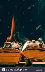 burning old book stock image