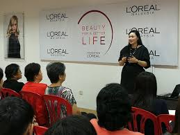 disadvaned young women graduate as certified hairdresserakeup artists through l oreal msia s beauty for a