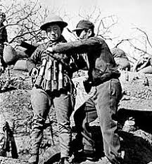 anti tank grenade chinese suicide bomber putting on an explosive vest made out of model 24 hand grenades to use in an attack on ese tanks at the battle of taierzhuang
