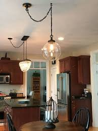 swag chandelier over dining table amazing pin by ruthie mcclelland on cool ideas light home