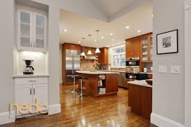 lush saturated wood tones add warmth to an expansive kitchen kitchen trends new england design and construction quartz countertops