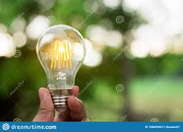 New Leaf Light Bulbs Hand Is Holding A Light Bulb For Save Energy Concept Or