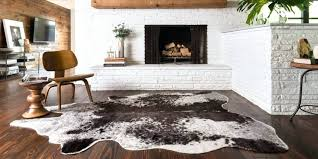 hide rugs rawhide rug faux home design ideas and cowhide london review buffalo for nz