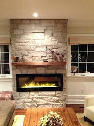 stone fireplace electric electric fireplace with natural stone barn beam mantel traditional living room stone electric