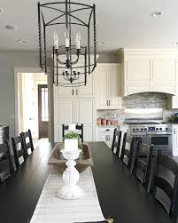 modern farmhouse kitchen with large table and lantern