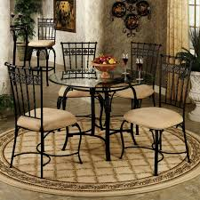 cream compact extending dining table: classic black metal chairs and small dining tables using round glass top in gorgeous room