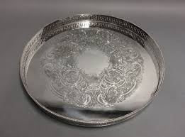 large round silver plated serving tray with fl decoration on the bottom so called