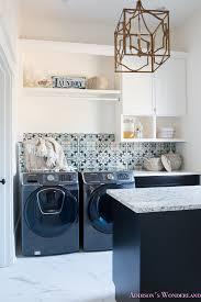 laundry-room-organization-ideas-white-black -cabinets-cement-tile-shaw-floors-marble-tile-flooring-carrera-black-window-sashes-alabaster-walls-sherwin-  ...