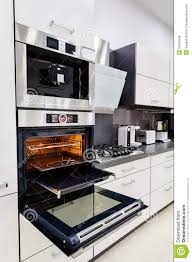 modern custom hi tek kitchen oven with open door stock photo image