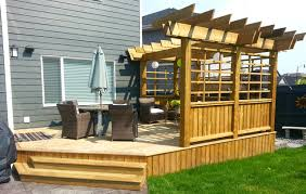 Treated Deck with Custom Privacy Screen and Pergola craftsman-deck