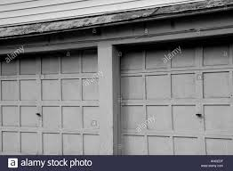 a pair of old garage doors along a street in martinsburg west virginia