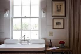 wall art lighting ideas. powder room with bathroom sink and window treatments also plug in wall sconce art lighting ideas