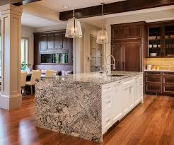 waterfall kitchen island with white base cabinet and dark wood main cabinets