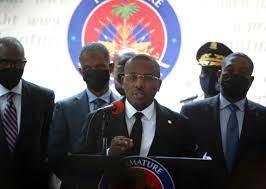 New Haiti Leader with International ...
