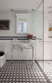 black and white hexagon tile floor. liz caan interiors llc, black and white tile floor, border over subway tile, sink on chrome legs hexagon floor r