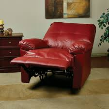 red leather reading chair with adjule footrest also recliner back feature next to wood drawer chest on cream carpet floor