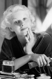 8th july 1932 jean harlow applying make up to her face in her