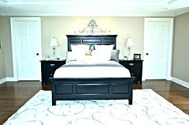 bed rug under area bedroom placement rugs best for master ideas on bath and beyond