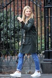 beaming beauty make up free sienna miller looked effortlessly chic in a green anorak