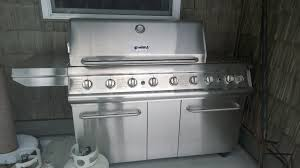 kenmore elite grill 6 burner. this grill is a professional grade with side burner and rotisserieit 10 years old should have some parts replaced inside, kenmore elite 6 m