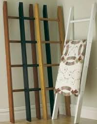 9 best Quilt racks images on Pinterest | Shops, Blanket and Blankets & Custom Quilt Hangers, Quilt Racks and Quilt Stands love the different colors Adamdwight.com