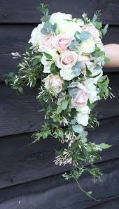 Blues instead of blushes. blush roses, silver dollar eucalyptus, and a  romantic trail