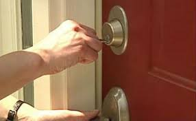 person locking door. THROUGH THE FRONT DOOR Person Locking Door K