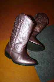 i nabbed these pink metallic leather cowboy boots from my sister in law a couple of weeks ago they were my niece s and she had outgrown them