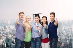 group of students diploma showing thumbs up stock photo  group of students diploma showing thumbs up stock image
