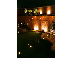 the outdoor garden illuminated under the lights at the ivy hotel