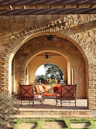 country living room ci allure: outdoor loggia with arched entrance ci allure of french and italian decor arched stone wall outdoor room pg xjpgrendhgtvcom