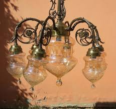 large sized bronze chandelier with fl motif decorated stained glass parts italy early 20th century