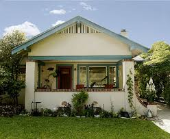 like an open smile the 1922 stucco bungalow welcomes visitors without pretense it s in